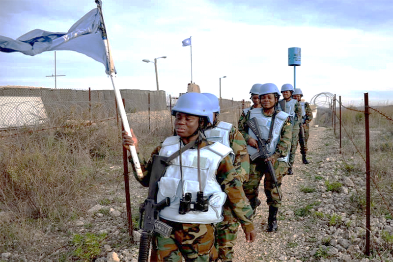 Ghanaian women peacekeepers carry out foot patrol along the 23-km stretch of the Blue Line, which is essential to maintain the existing calm in the area.