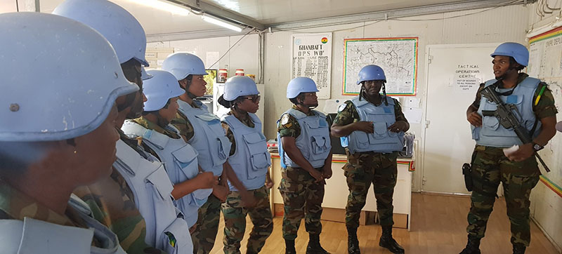 One of the key tasks of Ghanaian peacekeepers is to conduct day and night patrols. These female peacekeepers receive a briefing from their platoon commander before embarking on a patrol.