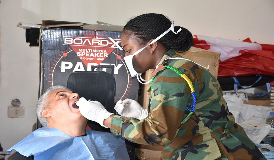 "Captain Odei-Kissi Henrietta, a dentist who has served in the Ghanaian Army for 14-years, says: ""My passion is to help people. There are several people who are not able to afford dental care. It is therefore an honour to serve the local people through the use of my skills."""