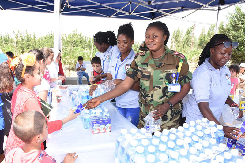 Lieutenant Lucy Doliba and her team distribute food supplies at a children's festival in Tibnin.