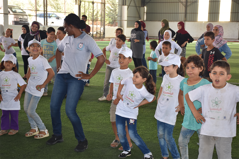"Sergeant Kpeem Cynthia leads an aerobics session with children of a special needs school at Ayta ash Sha'ab. She says: ""It is such a privilege to bring joy and smiles to the faces of these children."""