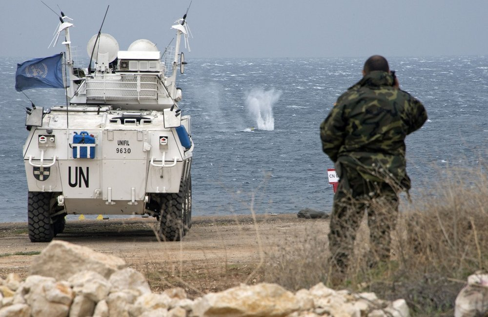 A UNIFIL Spanish peacekeeper watches as a UNIFIL armoured patrol carrier shoots targets at sea during the Steel Storm exercise.
