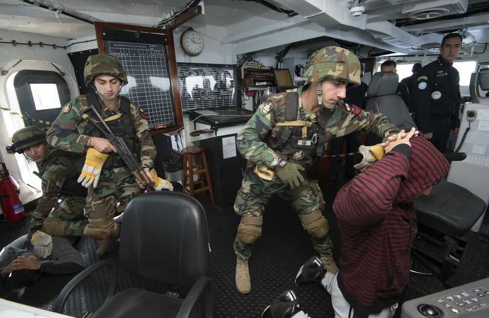The LAF Navy boarding team takes control of the uncooperative ship's bridge observed by a UNIFIL MTF training officer.