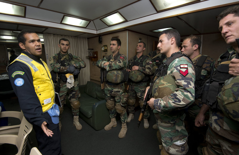 A UNIFIL MTF officer debriefs the LAF Navy boarding team, congratulating them on their professional handling of the exercise.