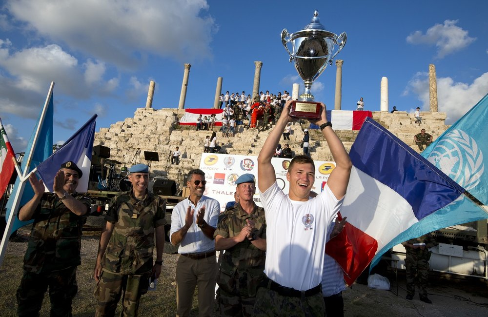UNIFIL's Force Commander Reserve (FCR) team captain raises the Military Olympiad Cup - 2017.