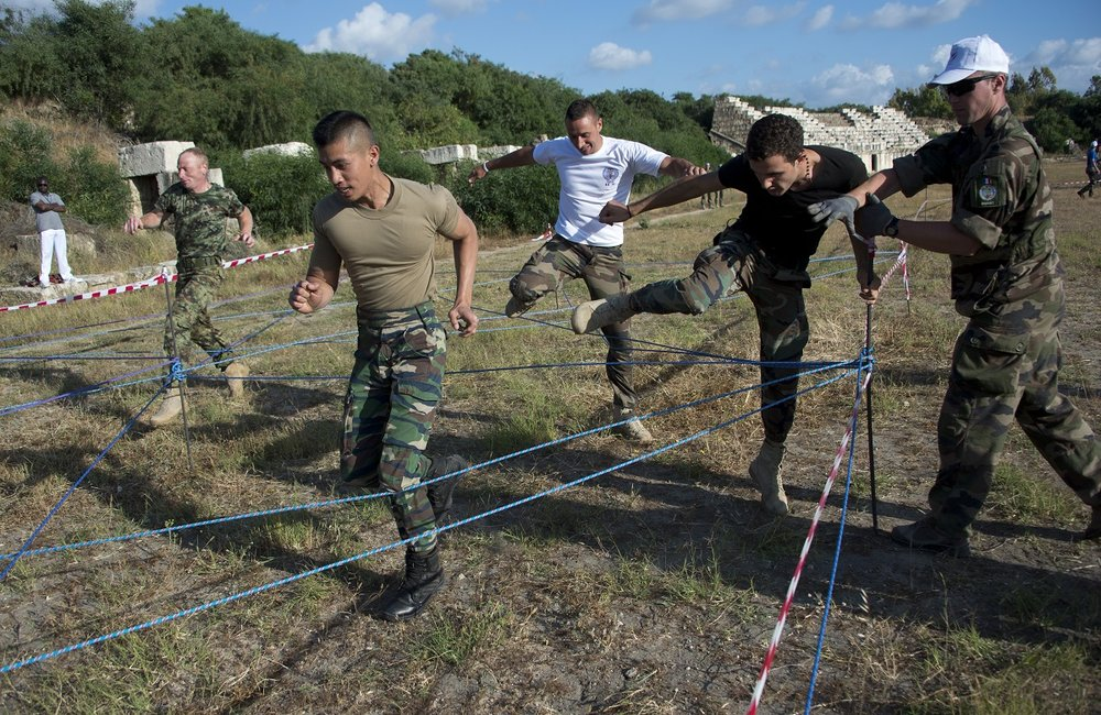 UNIFIL peacekeepers and LAF soldiers run through a web of ropes during the Olympiad.