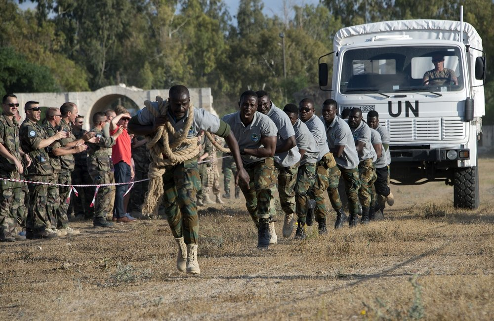 Ghanaian peacekeepers pull a 6,100-kg truck during the Olympiad.
