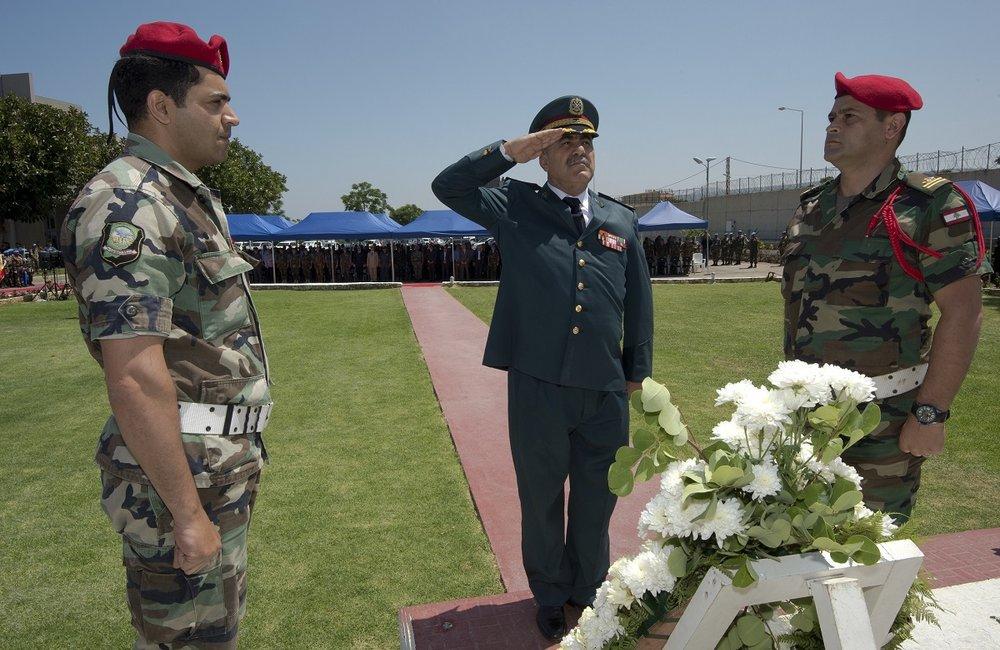 Lebanese Armed Forces representative Brigadier General Abbas Zamat salutes at the UNIFIL cenotaph.