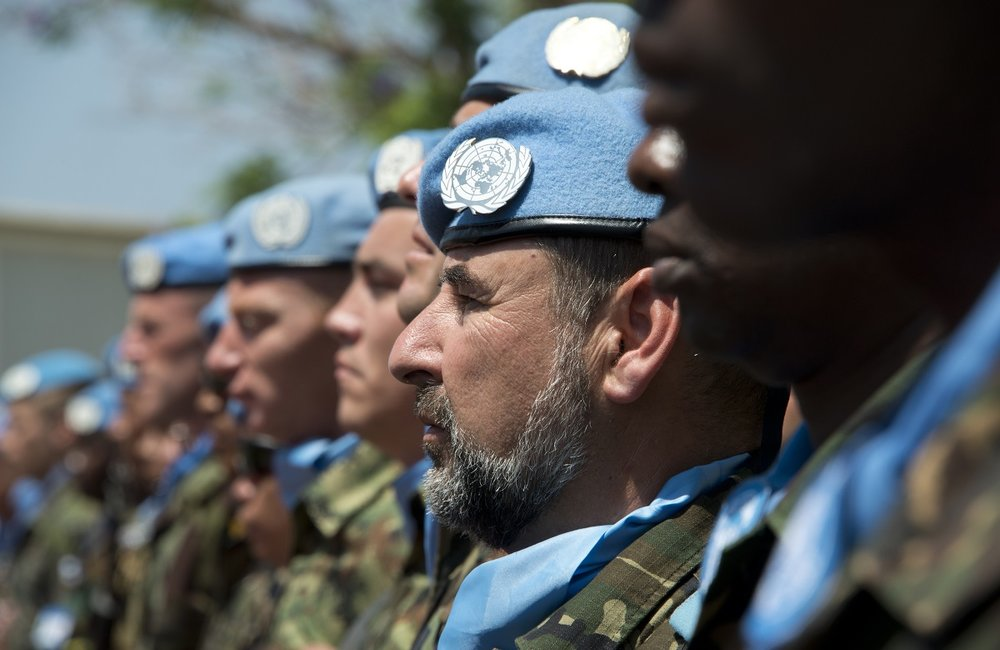 UNIFIL peacekeepers pay a guard of honour during a ceremony marking the International Day of UN Peacekeepers.