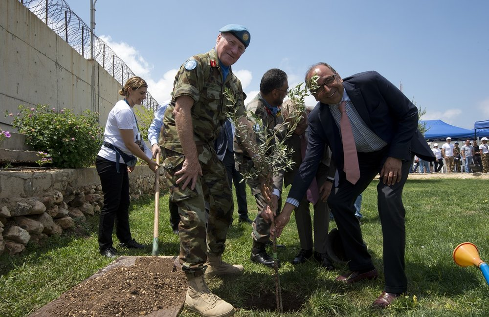 UNIFIL Head of Mission and Force Commander, Major General Michael Beary, and UNIFIL Deputy Head of Mission, Mr. Imran Riza, plant an olive tree during the ceremony for 2017 World Environment Day in Naqoura.