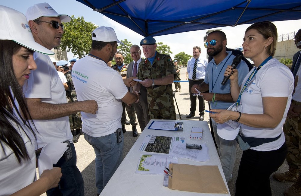 UNIFIL Head of Mission and Force Commander, Major General Michael Beary distributes the first questions for the relay quiz.