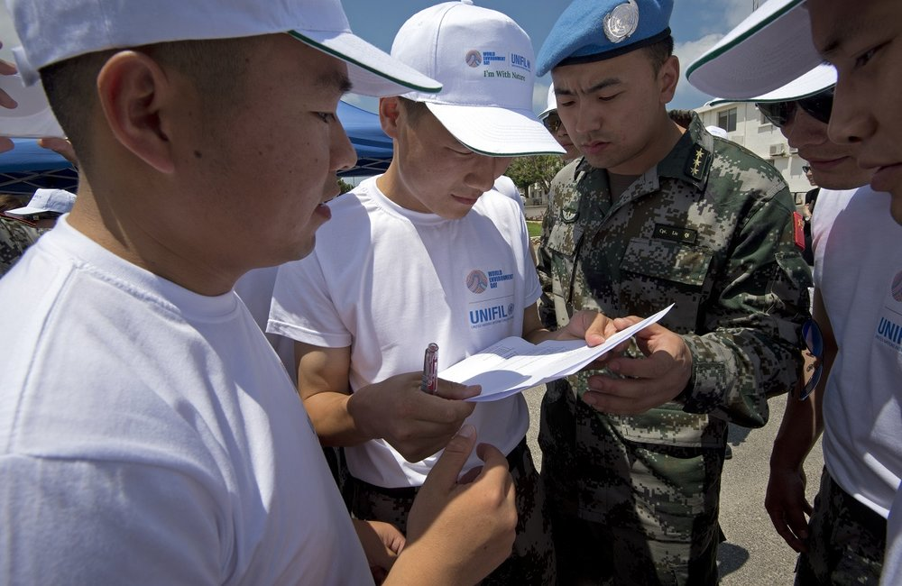 """A team of UNIFIL Chinese peacekeepers race to answer the environmental questions in the """"Rally Paper"""" event."""
