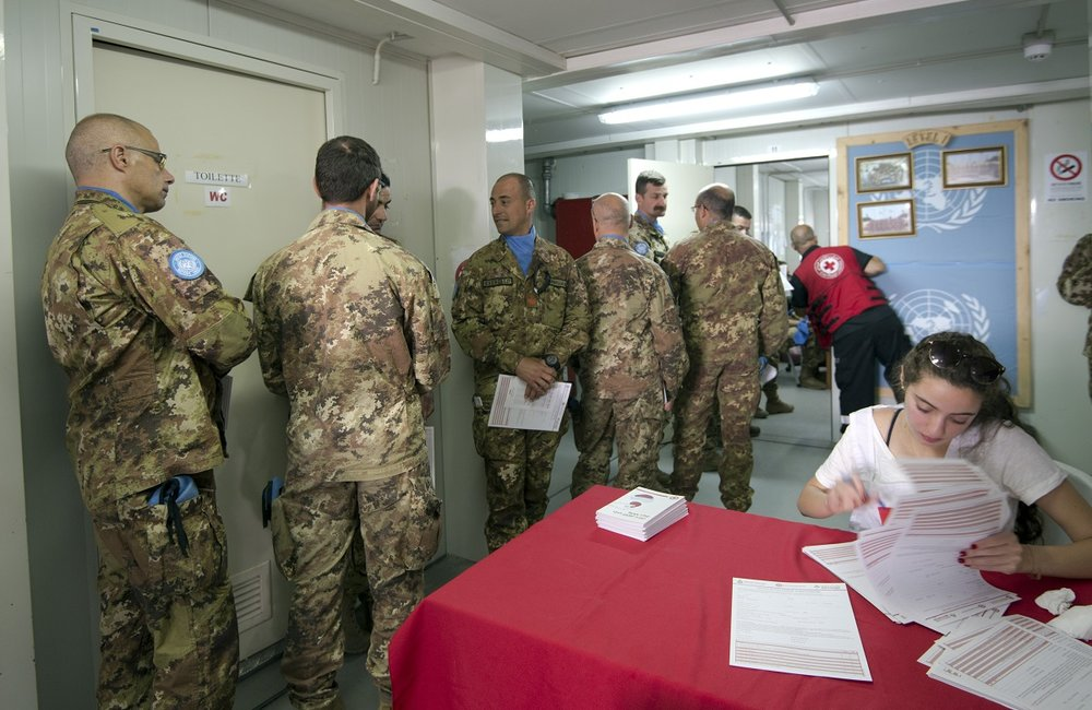 UNIFIL peacekeepers queue up to donate blood.