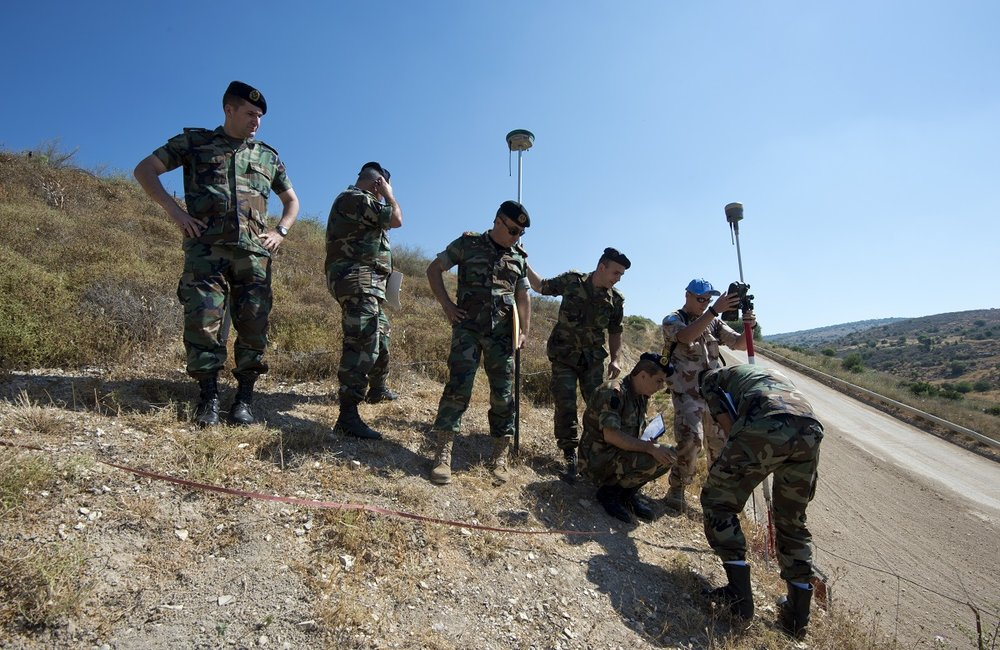 On a steep incline, the LAF and UNIFIL geographical teams measure the coordinates a of new Blue Line point near Blida, south-eastern Lebanon.