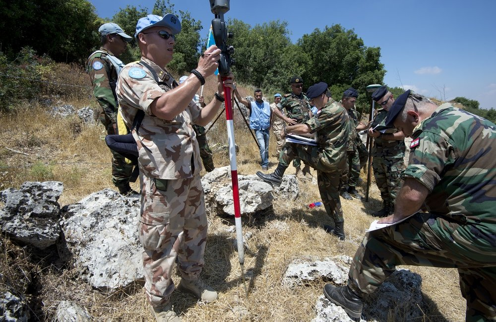 A peacekeeper from UNIFIL's geographical team checks the coordinates of a Blue Line point measured by LAF geographical teams, near the town of Houla.