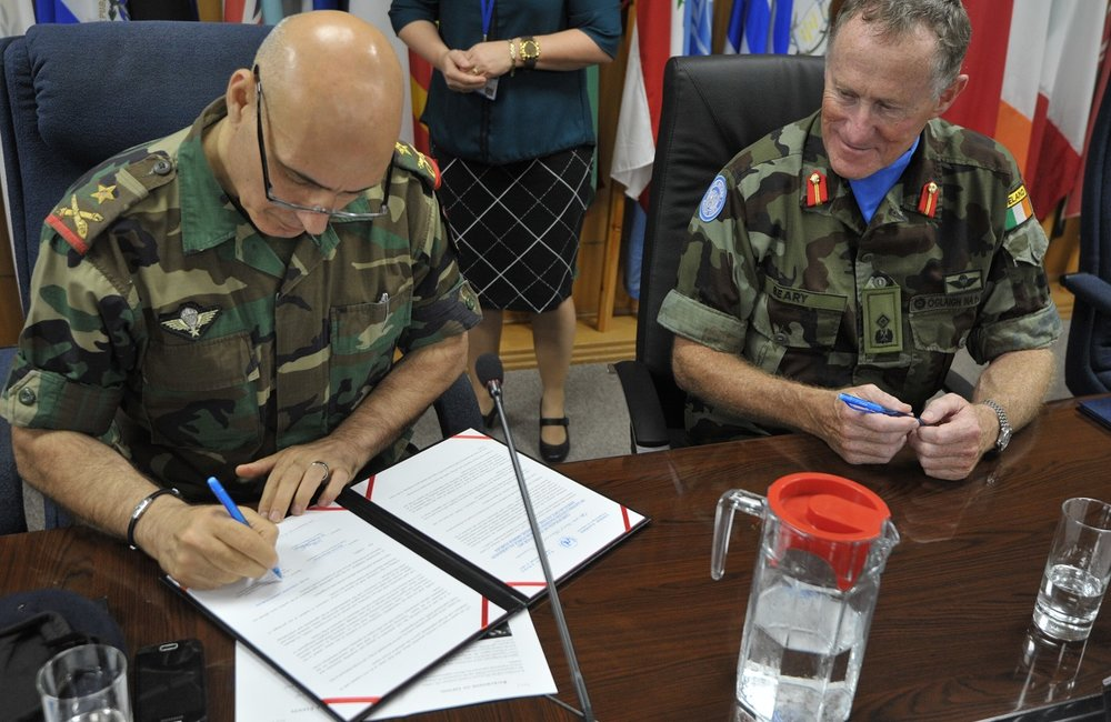 Brigadier General Mohammed Janbay of the Lebanese Armed Forces (LAF) signs a receipt of the equipment donated by UNIFIL.