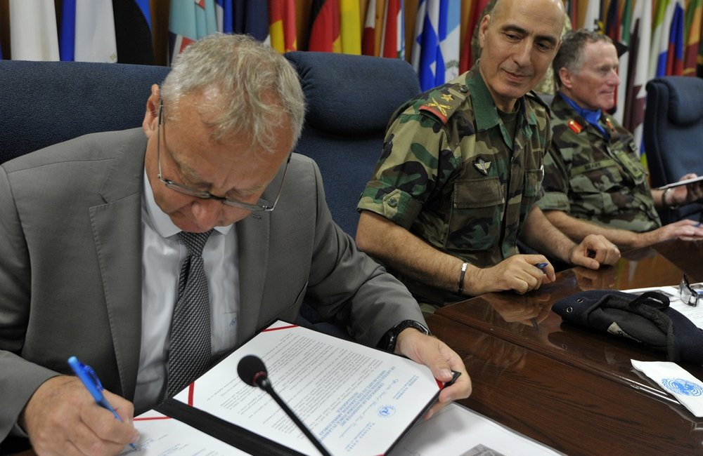 UNIFIL Director of Mission Support, Wolfgang Weiszegger, signs over equipment to be donated to LAF and LAF Intelligence.