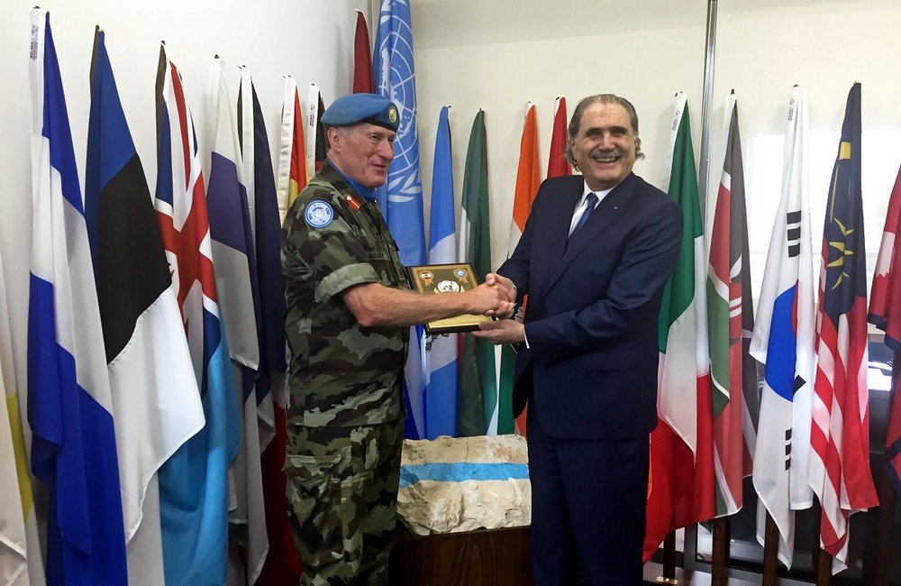 The Lebanese Minister of Justice Salim Jreissati receives a plaque from UNIFIL Head of Mission and Force Commander Major General Michael Beary at the UNIFIL headquarters in Naqoura, south Lebanon.