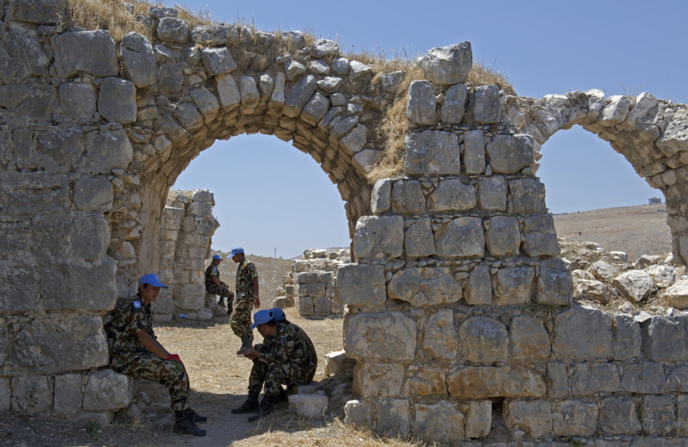 Nepalese peacekeepers during a break around the castle remains.