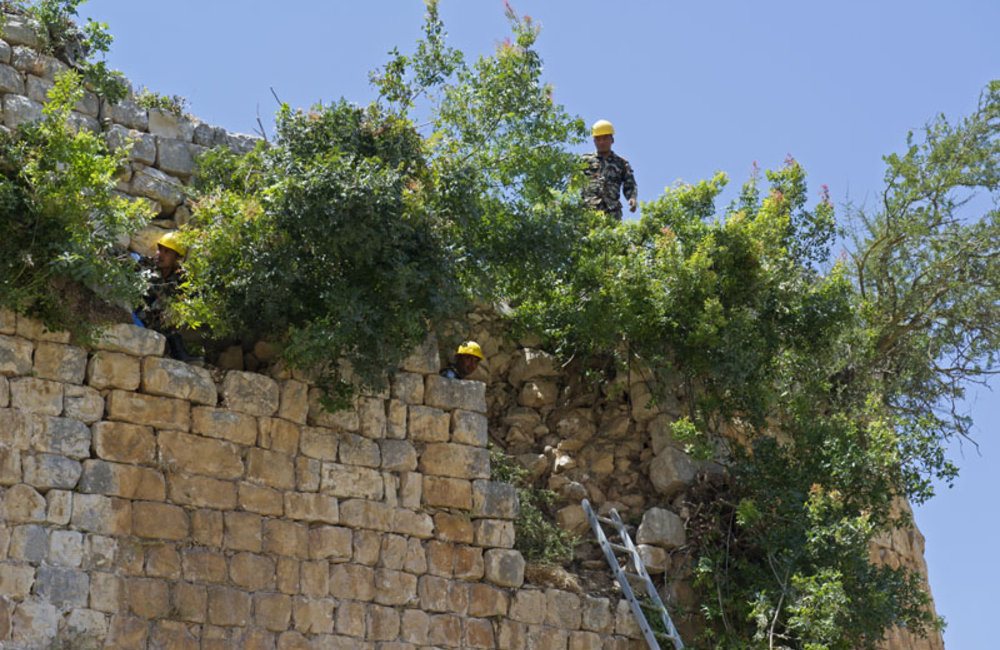 Nepalese peacekeepers working on the castle's walls.
