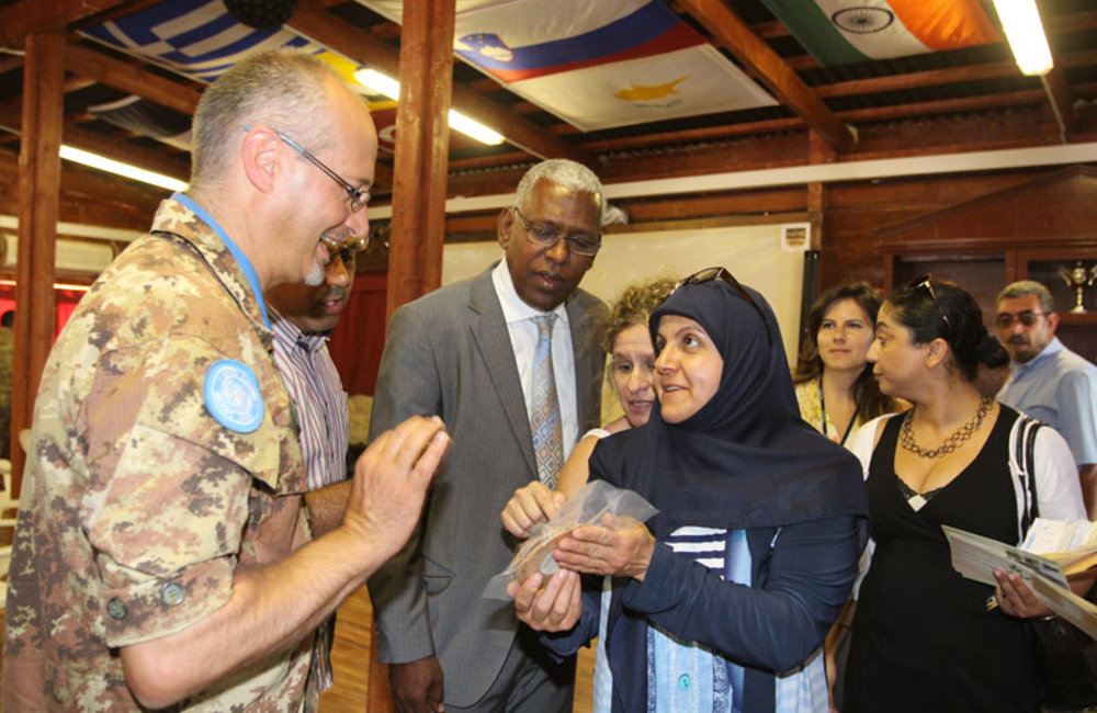 Ms. Salwa Bazzi presenting one of the products to UNIFIL Sector West Commander Brig Gen Vasco Angelotti and to UNIFIL Chief Civil Affairs Mr. Albagir Adam.