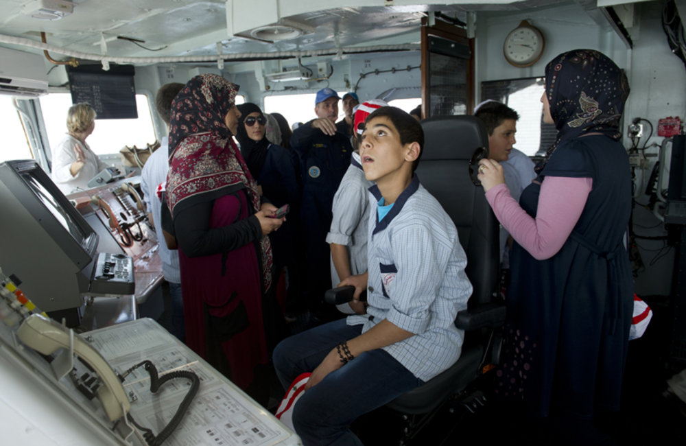 Students on the bridge of the ship, being briefed about the ship equipment and capabilities.