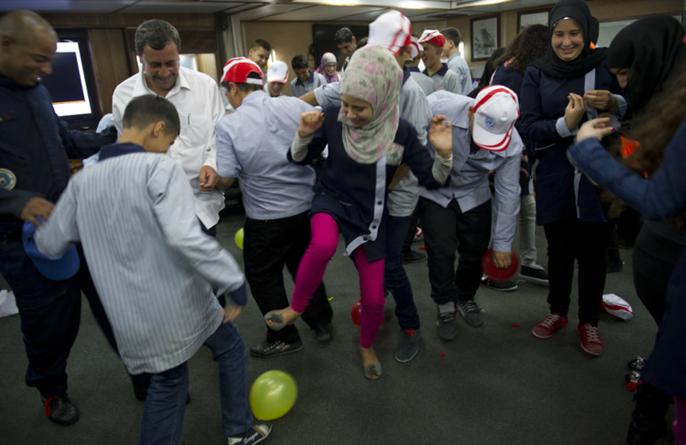 The students greatly enjoyed the surprise balloon games on board the Maritime Task Force vessel.