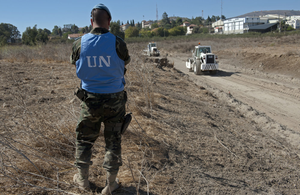 UNIFIL Spanish peacekeeper securing the perimeter of the water channel construction site in Kfar Kila, South Lebanon.