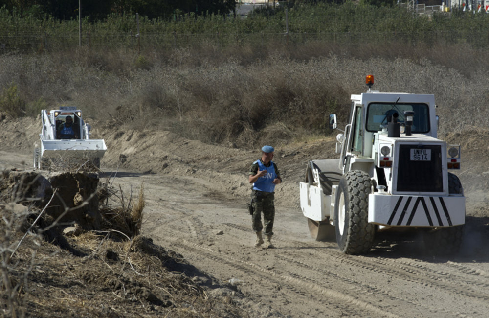 UNIFIL Spanish officer giving instructions to the road roller operator.
