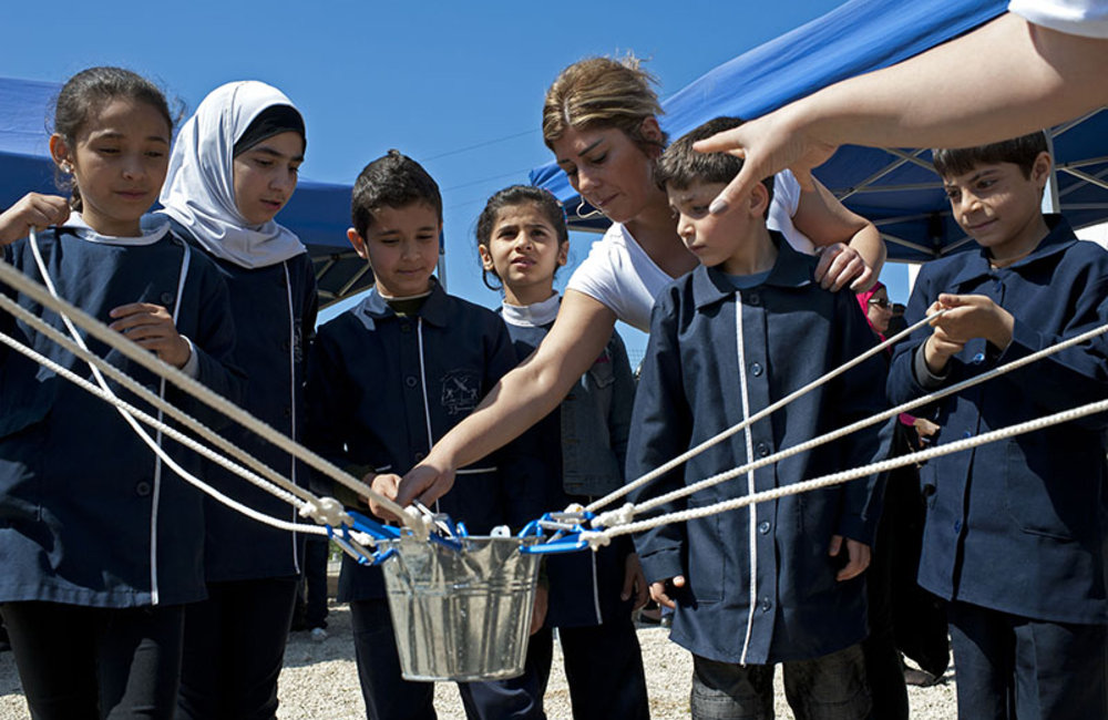 Children performing team work activities during World Water Day celebration held in Tyre.