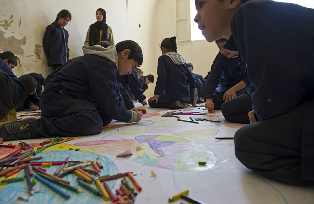 Children from local schools in Tyre painting a mural during the celebration of World Water Day held in Tyre.