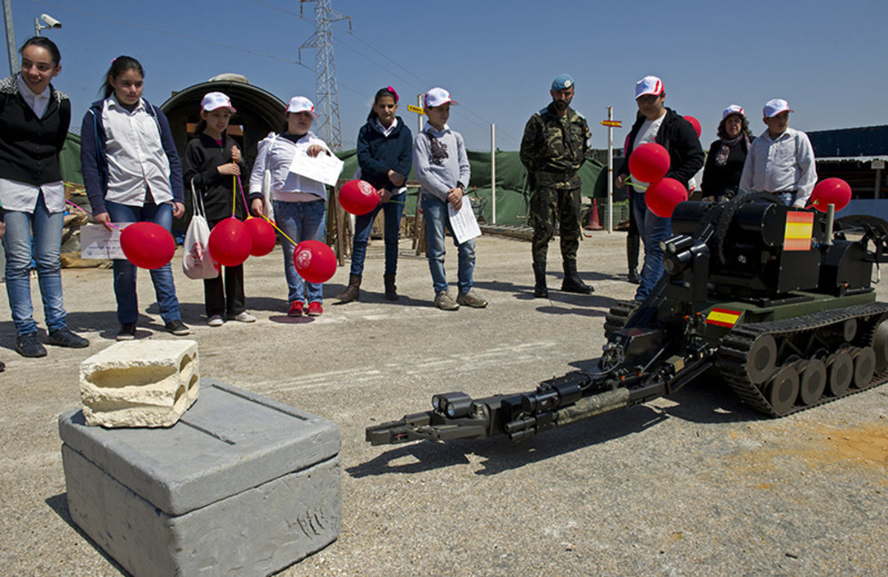 A demining robot approaching a mock explosive device at UN Position 7-2 in Sector East during International Day of Mine Awareness.