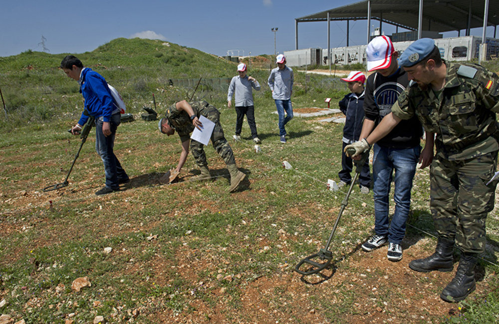 School children practicing with metal detectors in a mock mine field at UNIFIL Sector East in Marjayoun during International Day of Mine Awareness.
