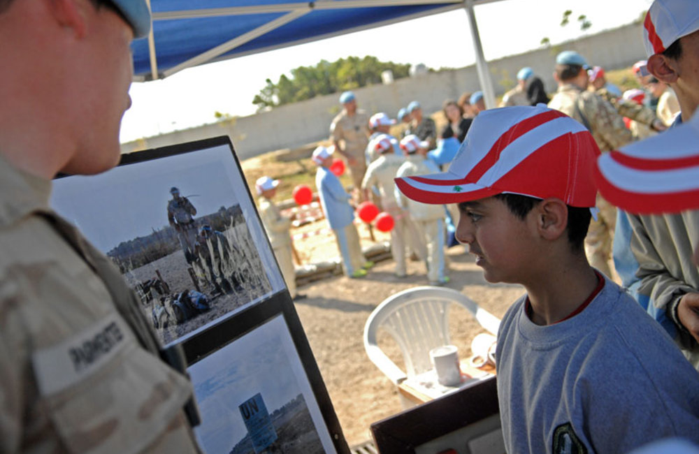 UNIFIL Belgian de-miner explains to students about de-mining stages during the International Day of Mine Awareness at UNIFIL HQ in Naqoura.