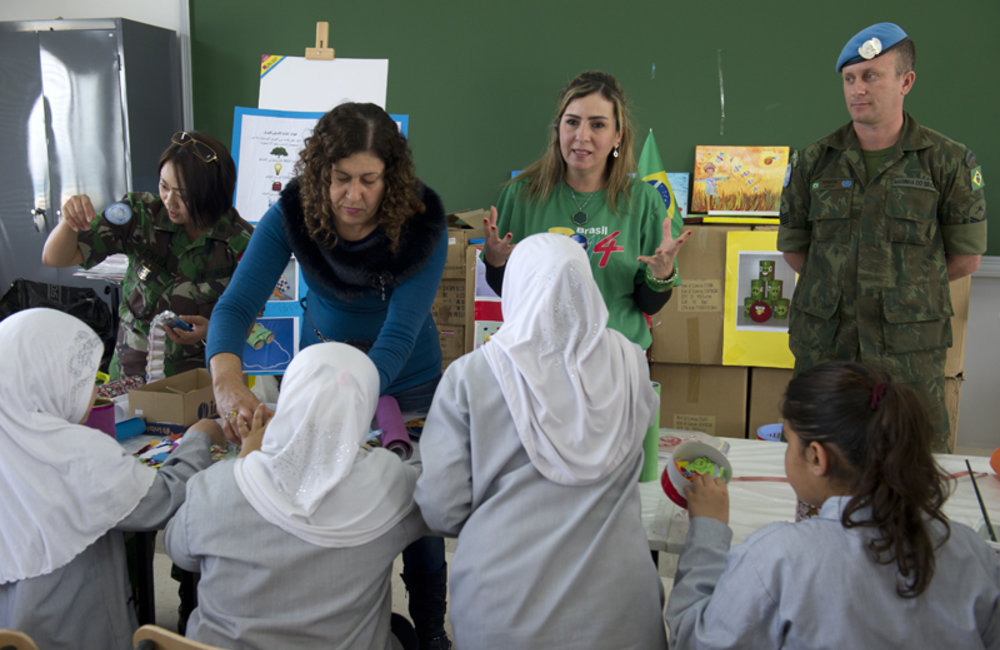Lebanese-Brazilian recycle art specialist Katia Awar explaining to the students how to turn recycled material into art.