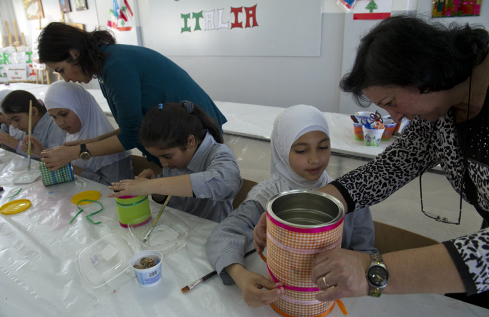 Trainers helping the students to turn disposable material into -objects d'art-.