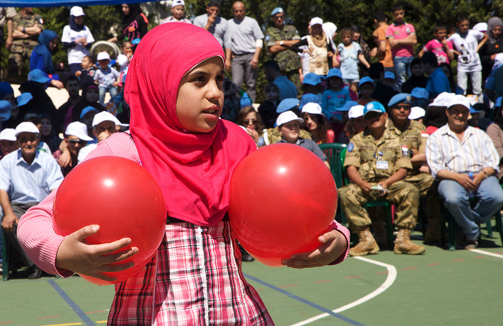 Girl carrying balloons during an entertainment performance.