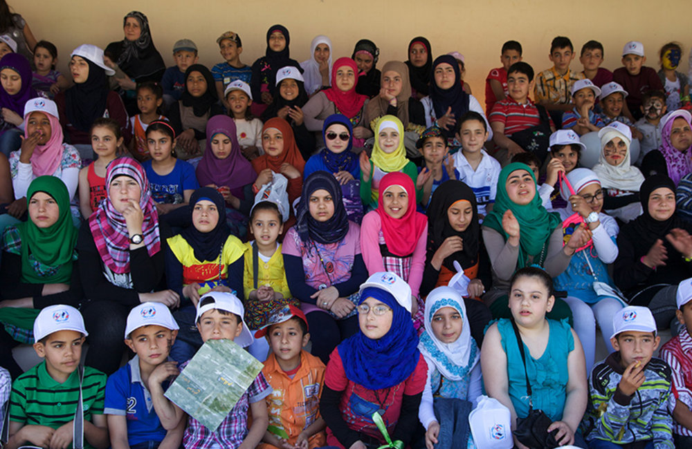 Group of pupils from the region of As Sultanyieh watching performances.
