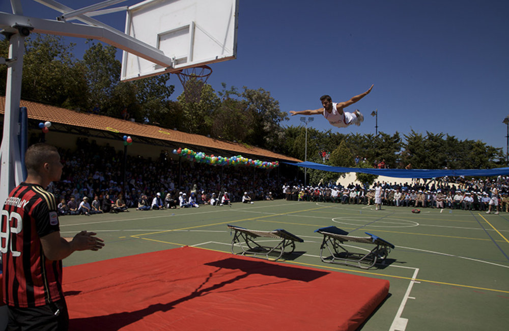 Athlete from Gymbo Team showing acrobatic jumps to children and peacekeepers during the Spring Festival.