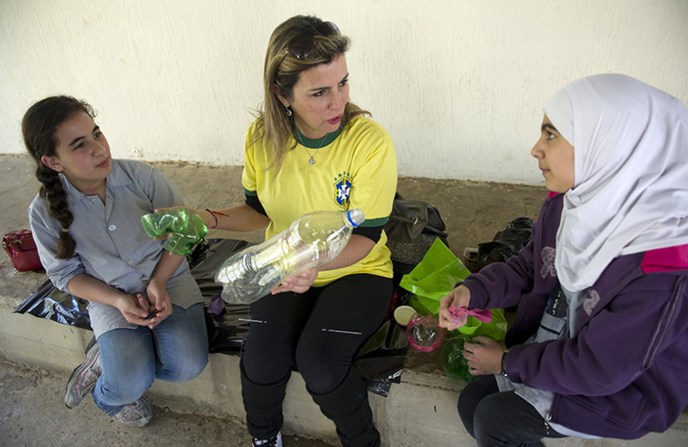 Trainer showing public school children how to recycle plastic trash during a workshop organized by UNIFIL Civil Affairs and in Tyre, South Lebanon.