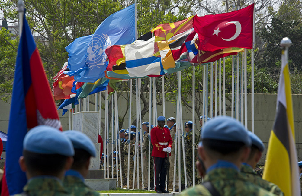 Peacekeepers hoisting the flags of the UN, Lebanon and the 37 UNIFIL troop contributing countries at the ceremony commemorating International Day of UN Peacekeepers held at UNIFIL Headquarters in Naqoura, south Lebanon.