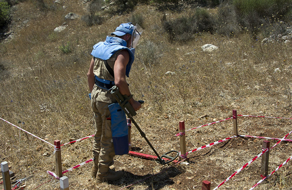 UNIFIL BELUBATT peacekeeper operating with mine detector during a medical evacuation exercise.
