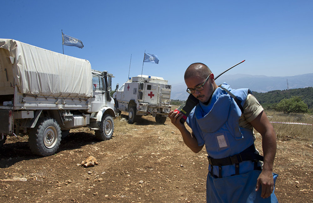 Belgian peacekeeper operating radio communication as ambulance leaves during a medical exercise, near Houla, south Lebanon.