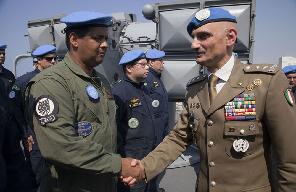 Major-General Luciano Portolano, UNIFIL Force Commander and Head of Mission greets a Brazilian member of the UNIFIL Maritime Task Force in Beirut port, Lebanon.