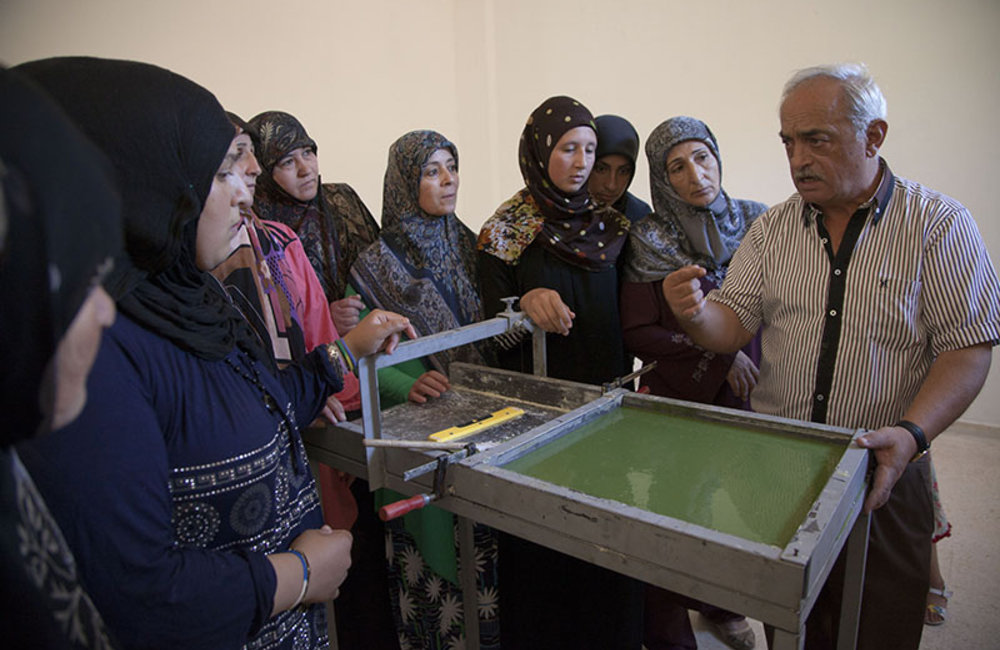 Teacher talking to women from Ramieh village about soap making process, in south Lebanon.