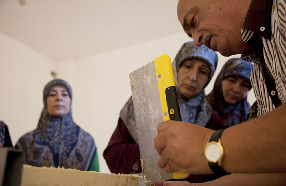 Women watching teacher levelling freshly made soap in Ramieh village, south Lebanon.