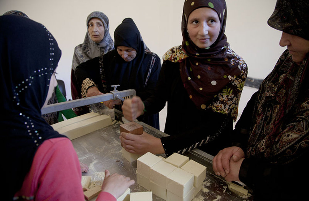 Women compacting new soap during training in Ramieh, south Lebanon.