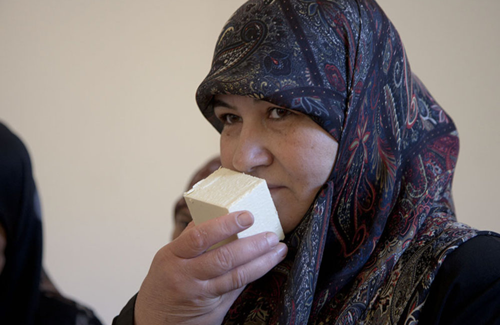 Woman from Ramieh village smelling a soap that she just made during a training financed by UNIFIL.