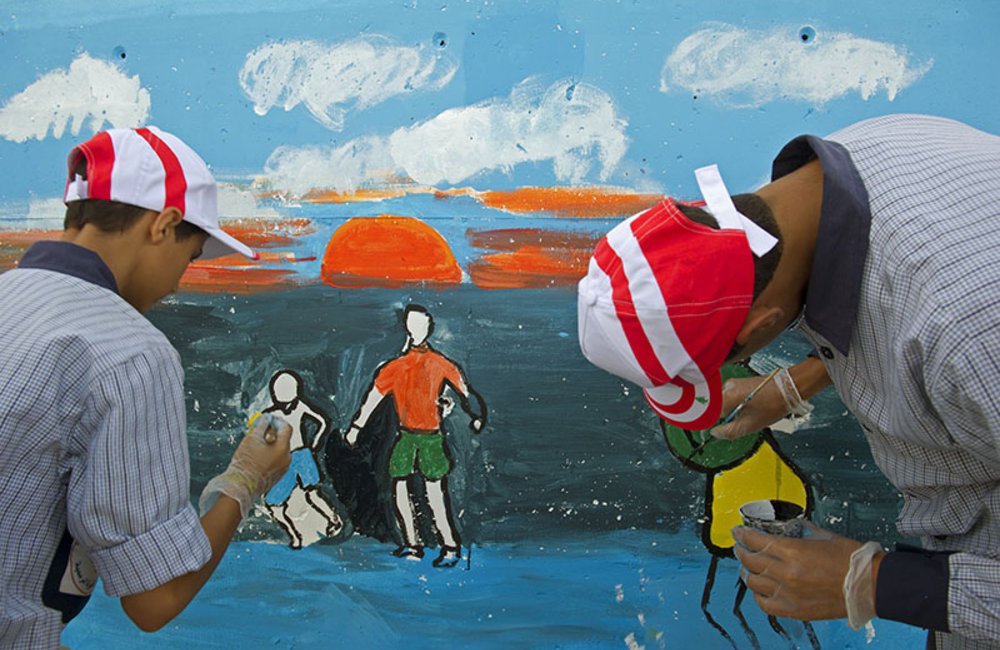 """Students participating in the 'Painting for Peace"""" activity organized by UNIFIL for International Day of Peace, at UNIFIL HQ in Naquora."""