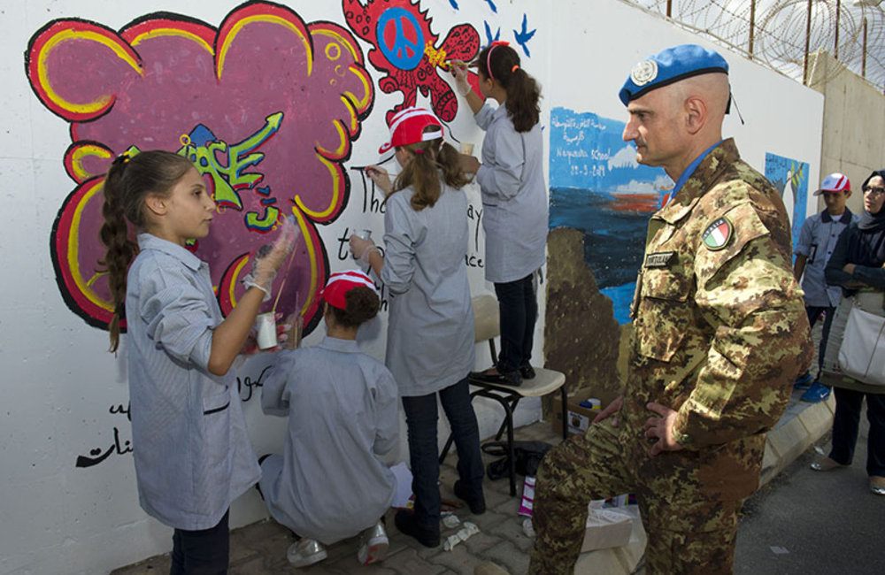 UNIFIL Head of Mission and Force Commander Major-General Luciano Portolano speaking with the students involved in the 'Painting for Peace' activity at UNIFIL HQ.